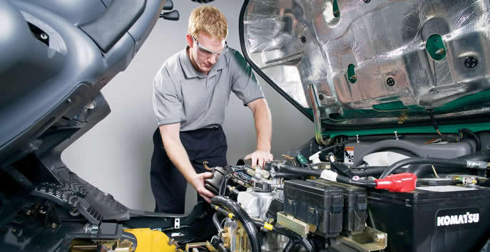 Auto Technician Examining Automotive Elements