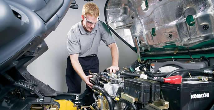 Auto Technician Examining Automotive Elements