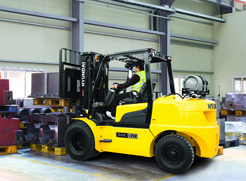 Operator Using Forklift to Move Equipment