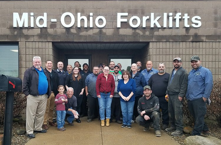 Team at Mid-Ohio Forklifts Assembled in Front of Building